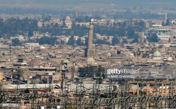 A picture taken on March 24 2017 shows a general view of the west Mosul skyline featuring the leaning AlHadba minaret in Mosul where Islamic State...
