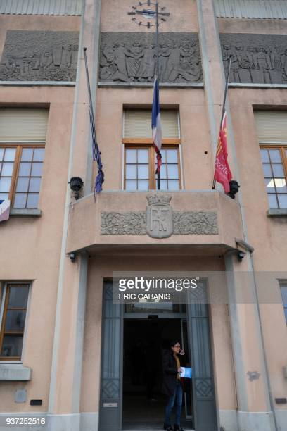 A picture taken on March 24 2018 at Trebes townhall near Carcassone southwestern France shows flags put at half mast after a string of attacks by a...