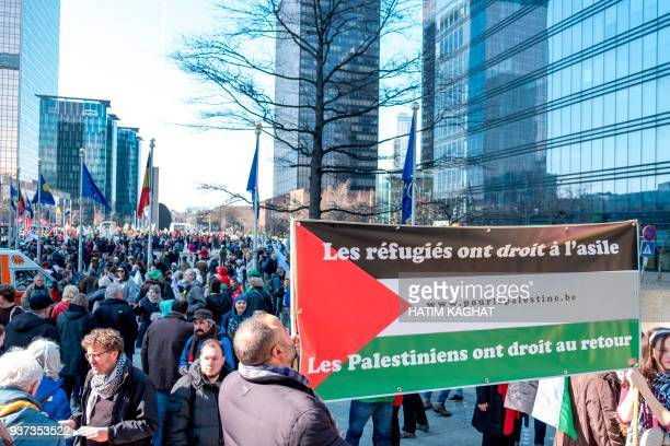 A picture taken on March 24 2018 shows people taking part in a national protest against racism hatred discrimination unequality and agression...