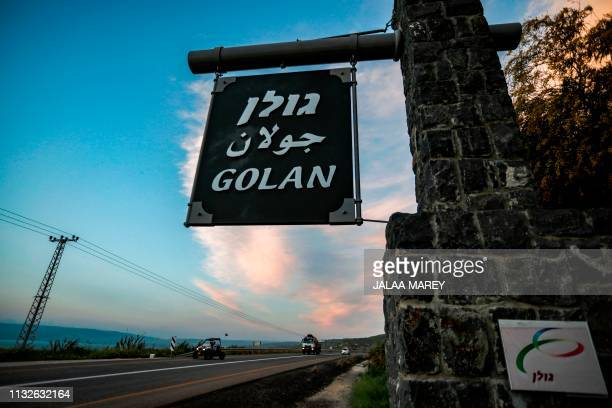 Picture taken on March 24, 2019 shows a sign reading Golan in Hebrew, Arabic, and English, located at the 1967 Israel-Syria border point, near the...