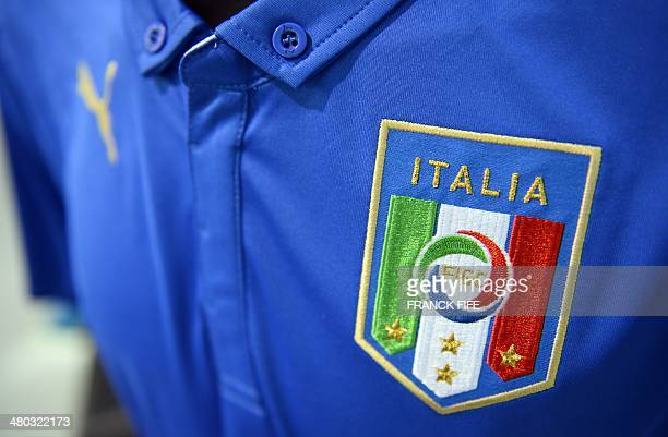 A picture taken on March 24 in Paris shows a partial view of the new jersey of the Italian national football team AFP PHOTO / FRANCK FIFE