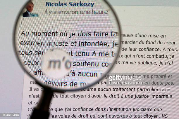 A picture taken on March 25 2013 in Paris shows words written the same day by former French president Nicolas Sarkozy on his Facebook page in which...