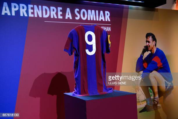 A picture taken on March 25 2017 shows the jersey of late Dutch football star Johan Cruyff under a text reading Learn to dream during a ceremony for...