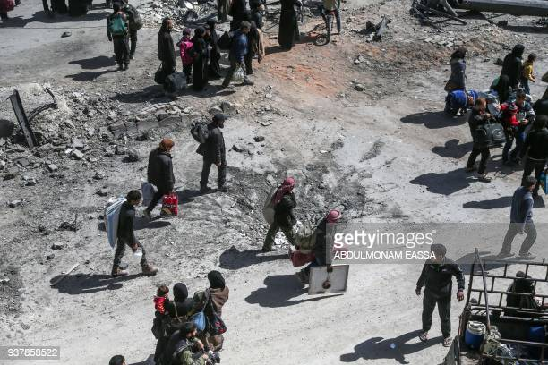 TOPSHOT A picture taken on March 25 2018 shows people preparing to evacuate from the town of Arbin in the Eastern Ghouta region on the outskirts of...