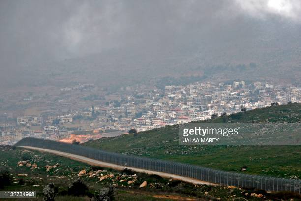 TOPSHOT A picture taken on March 25 2019 shows the Israeli fence separating the Israelioccupied sector of the Golan Heights near the Druze town of...