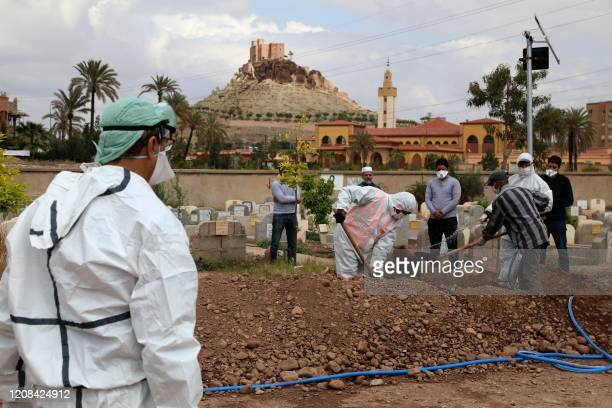 A picture taken on March 25 shows the burial of a victim of the COVID19 coronavirus in the Moroccan city of Marrakech