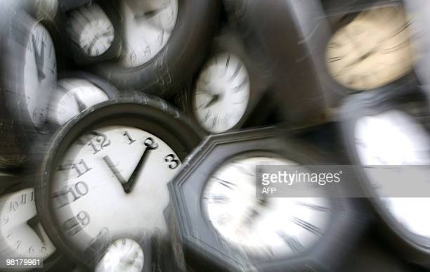 A picture taken on March 26 2010 shows a detail of a sculpture made of clocks at the SaintLazare train station in Paris Daylight Saving Time will...