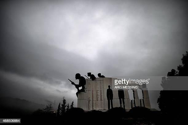 A picture taken on March 26 2015 in the small town of Distomo some 200 kilometers north west of Athens shows the memorial for the victims of Distomo...