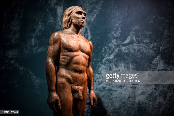 Picture taken on March 26, 2018 shows a reconstruction of the Man of Spy displayed for the Neanderthal exhibition at the Musee de l'Homme in Paris. /...
