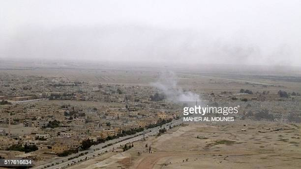 A picture taken on March 26 shows smoke billowing in Palmyra during a military operation by Syrian progovernement forces to retake the ancient city...