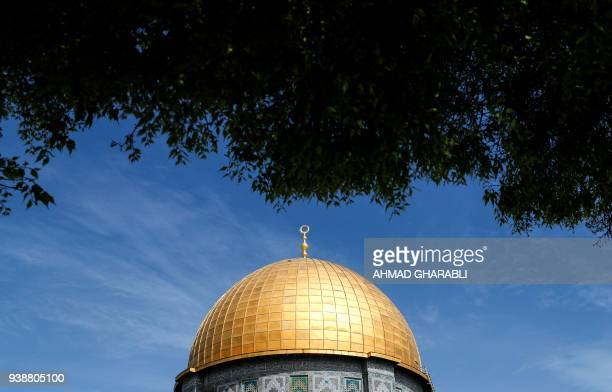 A picture taken on March 27 2018 shows a partial view of the Dome of the Rock in the Aqsa mosque complex also known to Jews as the Temple mount in...