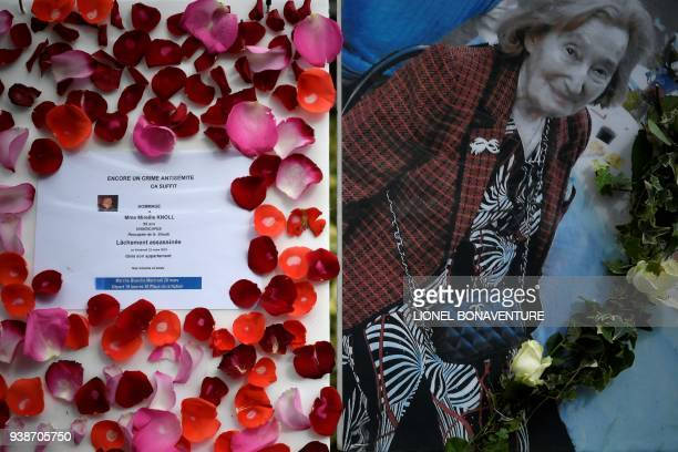 A picture taken on March 27 2018 shows a picture of Mireille Knoll and a message announcing a 'Marche Blanche' condemning the alleged antisemitic...