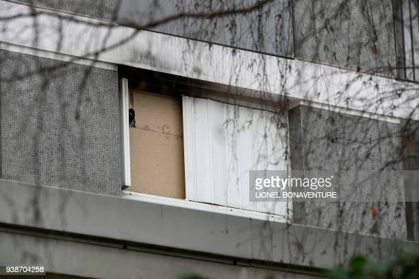 A picture taken on March 27 2018 shows the window of the apartment of Mireille Knoll in Paris sealed by the police after she was found dead in her...