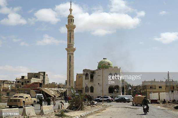 Picture taken on March 27 shows heavily damaged buildings in a residential neighbourhood of the modern town of Palmyra after Syrian troops recaptured...