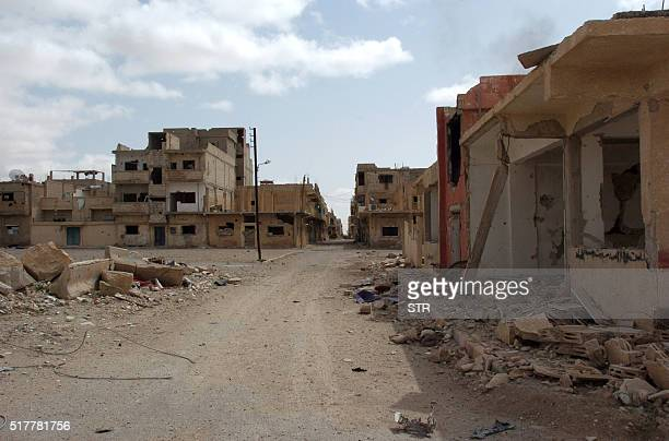 A picture taken on March 27 shows heavily damaged buildings in a residential neighbourhood of the modern town of Palmyra after Syrian troops...