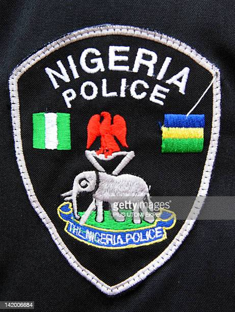 A picture taken on March 28 2012 in Lagos shows a Nigerian police arm badge The Nigeria Police Force which is as old as its colonial past came into...