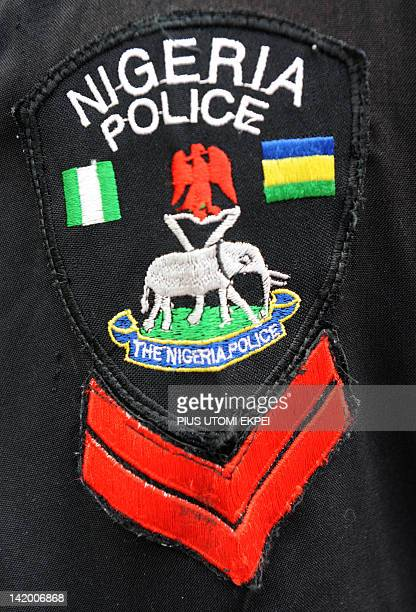 A picture taken on March 28 2012 shows the arm badge of a Nigerian corporal The Nigeria Police Force which is as old as its colonial past came into...