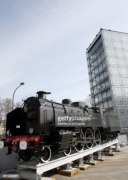 A picture taken on March 28 2014 in Paris shows the locomotive of the legendary train the Orient Express which is displayed in front of the Arabic...