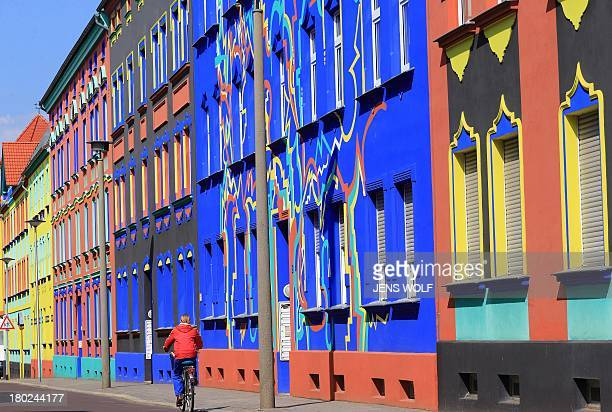 Picture taken on March 29 2013 shows colorfully painted buildings on the OttoRichterStrasse in Magdeburgeastern Germany Magdeburg was once the goto...