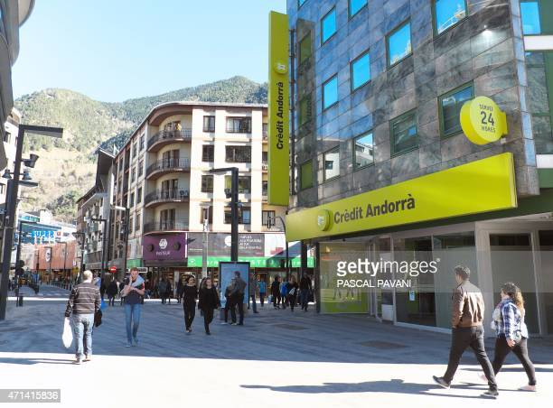 A picture taken on March 29 2015 shows people walking past a branch of the Credit Andorra bank in AndorralaVielle in the principality of Andorra AFP...