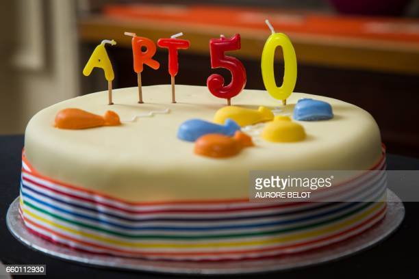 A picture taken on March 29 2017 shows a cake with decorations reading 'Art 50' during an event organized by members of the Europe and Freedom and...