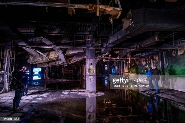 A picture taken on March 29 2018 shows a petting zoo area in the firegutted shopping mall in the industrial city of Kemerovo in western Siberia / AFP...