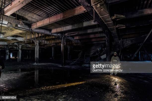 A picture taken on March 29 2018 shows a view of the firegutted shopping mall in the industrial city of Kemerovo in western Siberia / AFP PHOTO /...