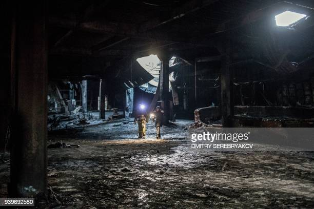 TOPSHOT A picture taken on March 29 2018 shows a view of the firegutted shopping mall in the industrial city of Kemerovo in western Siberia / AFP...