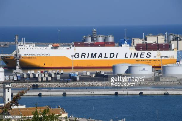 A picture taken on March 29 2019 shows the hybrid ship of Italian owner Grimaldi Lines Le Republica del Brasile of at the harbour of Sete southern...