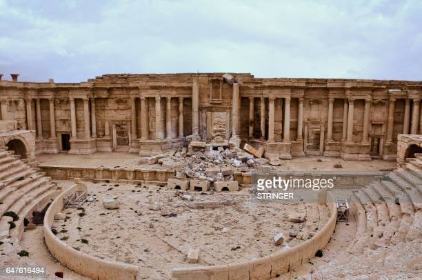 Picture taken on March 3, 2017 shows the damaged Roman amphitheatre in the ancient city of Palmyra in central Syria. - Syrian troops backed by...