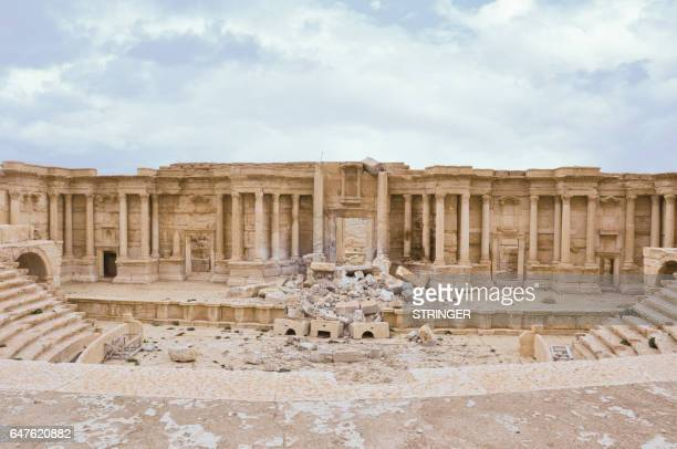 Picture taken on March 3, 2017 shows the damaged Roman amphitheatre in the ancient city of Palmyra in central Syria. Syrian troops backed by Russian...