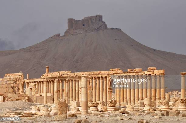 Picture taken on March 3, 2017 shows the Fakhr-al-Din al-Ma'ani Castle, known as Palmyra citadel, as it appears over the ancient city of Plamyra in...