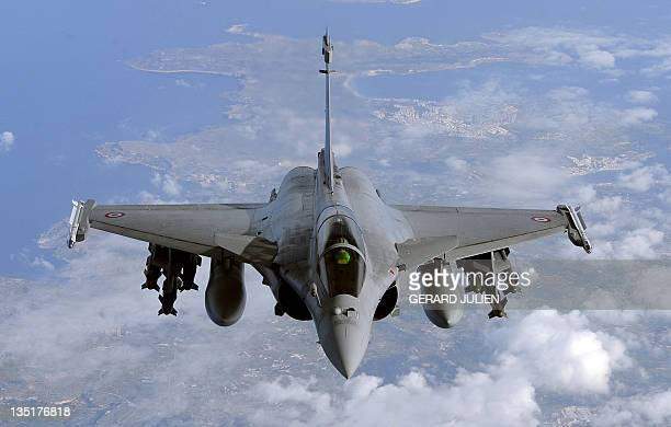 A picture taken on March 30 2011 shows a French Rafale fighter jet from the Istres military air base approaching an airborne Boeing C135 refuelling...