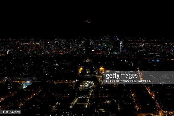 A picture taken on March 30 2019 shows the Eiffel Tower in Paris switchedoff during the a Earth Hour organised by the green group WWF Earth Hour is a...