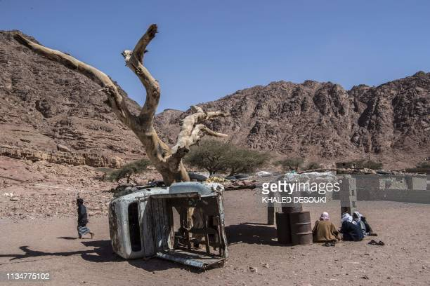 A picture taken on March 30 shows Egyptian Bedouins sitting in the village of alHamada in Wadi elSahu in South Sinai governorate In Wadi Sahu a...