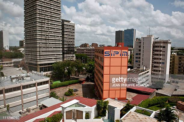 Picture taken on March 31 2011 shows deserted streets in the Plateau a business district in Abidjan Vehicles loaded with fighters backing...