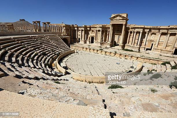 A picture taken on March 31 2016 shows a partial view of the roman theatre in the ancient city of Plamyra central Syria Syrian troops backed by...