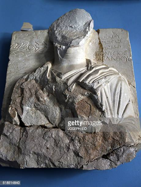 A picture taken on March 31 2016 shows beheaded and mutilated sculptures at the museum of the ancient city of Palmyra some 215 kilometres northeast...