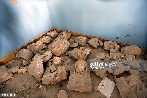 A picture taken on March 31 2016 shows pieces of beheaded and mutilated sculptures on the ground at the museum of the ancient city of Palmyra some...