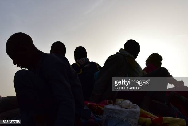 A picture taken on March 31 2017 shows West African migrants returning from Niger after fleeing Libya due to armed groups by pickup truck in Agadez...