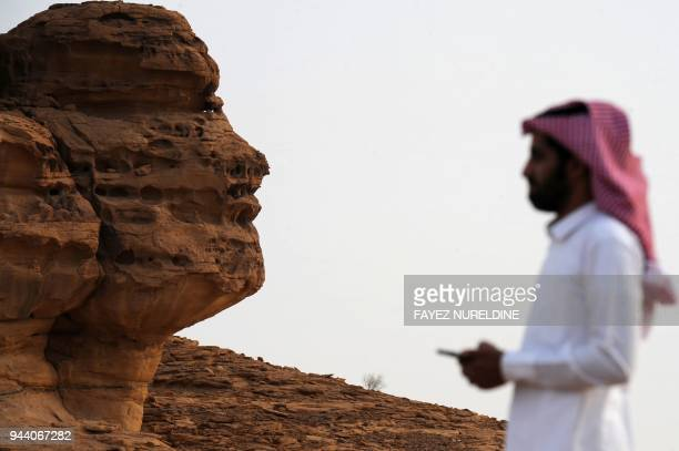A picture taken on March 31 2018 shows a Saudi man visiting the Khuraiba archaeological site near Saudi Arabia's northwestern town of alUla AlUla an...