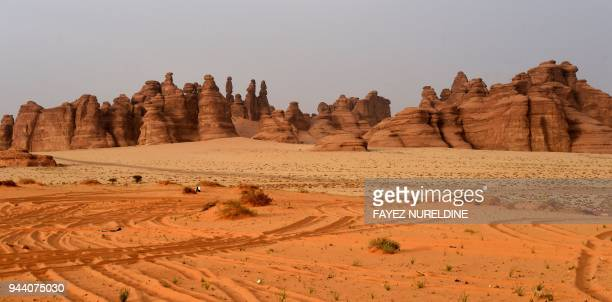 A picture taken on March 31 2018 shows rosecoloured sandstone in Madain Saleh a UNESCO World Heritage site near Saudi Arabia's northwestern town of...
