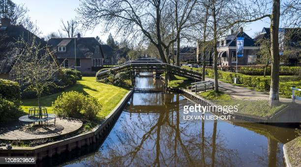 Picture taken on March 31, 2020 shows empty streets in Giethoorn, as the country is under lockdown to stop the spread of the Covid-19 pandemic caused...
