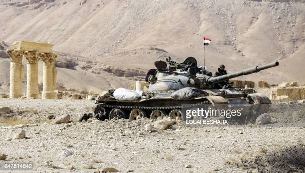 TOPSHOT A picture taken on March 4 2017 shows a Syrian army T62 tank at the damaged site of the ancient city of Palmyra in central Syria Syrian...