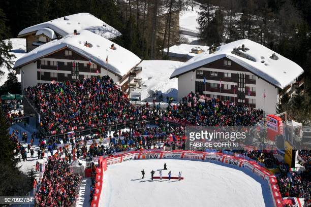 Picture taken on March 4, 2018 in Crans-Montana shows a general view of the arrival area with second placed Switzerland's Michelle Gisin, Winner...