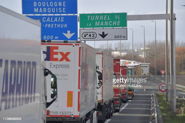 Picture taken on March 4, 2019 on the A16 highway between Dunkerque and Calais shows trucks heading to the Channel tunnel stuck in a traffic jam due...