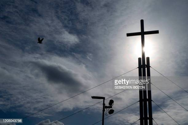 A picture taken on March 4 2020 in Mulhouse shows the cross above the Porte ouverte evangelical church where several persons have been contaminated...
