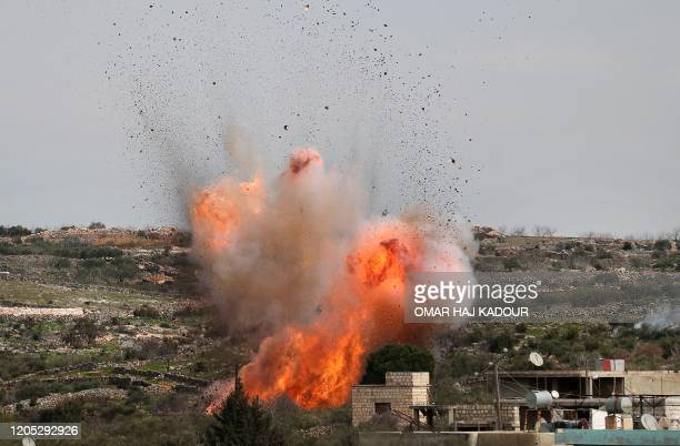 Picture taken on March 5, 2020 shows an explosion following Russian air strikes on the village of al-Bara in the southern part of Syria's...