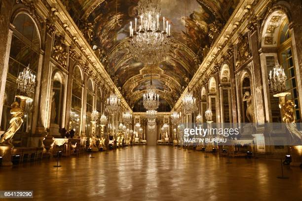 A picture taken on March 6 2017 shows a view of the galerie des Glaces painted by French artist Charles Le Brun at the Versailles Castle west of Paris