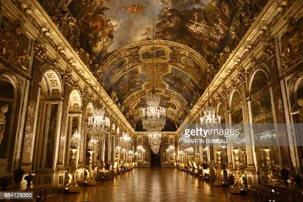 TOPSHOT A picture taken on March 6 2017 shows a view of the galerie des Glaces painted by French artist Charles Le Brun at the Versailles Castle west...